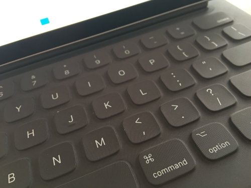 The Smart Keyboard has a very nice tactile feel, but lacks certain keys (like ESC, HOME, END)