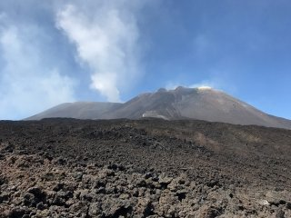 Climbing Mount Etna, an active volcano on Sicily Italy.