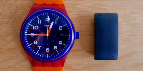 The Biostrap wrist PPG sensor next to a Swatch Sistem 51