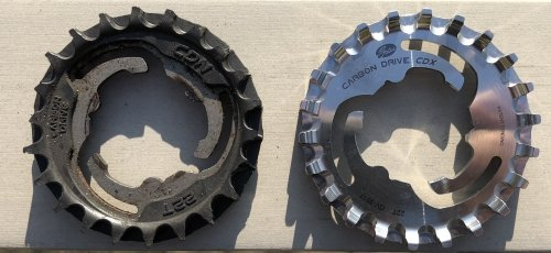 Left the plastic CDN sprocket - if you look closely you'll notice the missing teeth, right the shiny stainless steel CDX sprocket