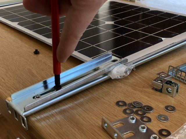 Clamping the solar panel using server parts