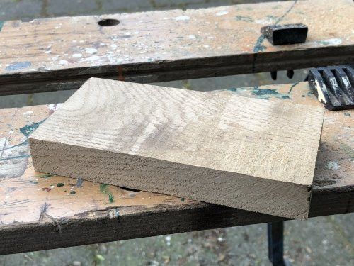 Raw piece of oak wood - right before machining