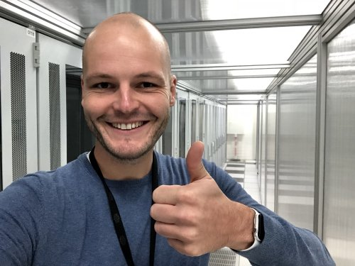 Happy engineer with Apple Watch inside the data centre!
