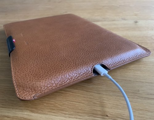 The iPad can be charged while tucked away in its case