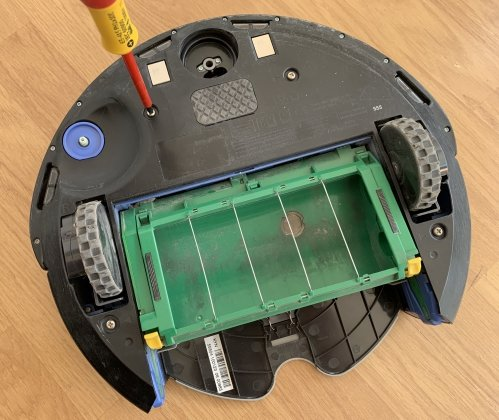 Remove the bottom cover to access the inside of the Roomba