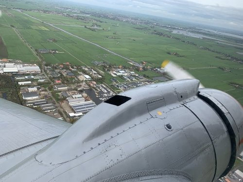 Flying over the village of Heeg with IJlst en Sneek visible on the horizon