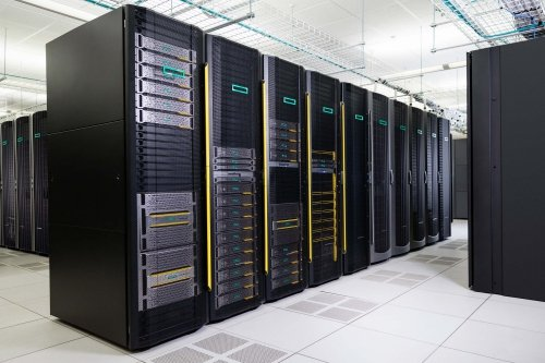 Servers in a datacenter: the black racks are like closets for the grey server computers, each rack fits multiple servers (photo: HPE).