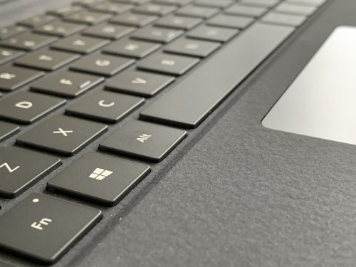 The keys are 'real' and there is a nice multi touch glass trackpad