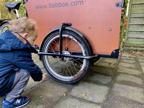 My small colleague inspecting the damage to the cargo bike