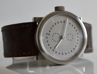 Last month I received my custom made wristwatch from Switzerland, it is a minimalistic mechanical annual calendar designed to be understated and true to the metal.
